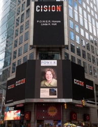 Linda K. Holt Honored on the Reuters Billboard in Times Square in New York City by P.O.W.E.R. (Professional Organization of Women of Excellence Recognized)